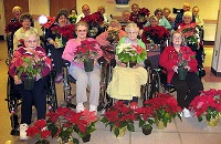 Seniors with poinsettias